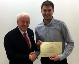 Matthew Sudderick receiving his certificate from Dr Skipp Truitt